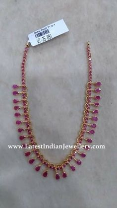 Simple Ruby Necklaces Here are two simple ruby necklace designs in 20 and respectively. These ruby necklaces are suitable for kids or adults alike Ruby Necklace Designs, Gold Ruby Necklace, Gold Necklace Simple, Gold Jewelry Simple, Ruby Jewelry, Simple Necklace Designs, Baby Necklace, Small Necklace, Jewellery Earrings