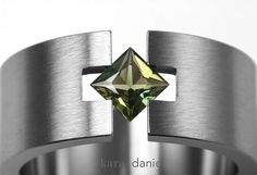 green sapphire ~ in hand carved stainless steel ring tension setting by kara   daniel, via Flickr