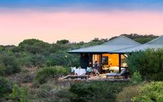 Kwandwe in the center of South Africa's malaria-free area near Grahamstown. The reserve is a member of the exclusive Relais & Chateaux portfolio. Private Games, Game Reserve, Lodges, South Africa, Adventure, House Styles, Guest Room, Outdoor Decor, Safari