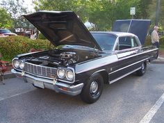 1964 CHEVY IMPALA SS 409. Papa taught me how to drive in this car! lol
