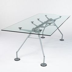 NORMAN FOSTER    Nomos dining table    Tecno  United Kingdom/Italy, 1989  powder-coated steel, glass, rubber  86.5 w x 39.5 d x 29.25 h inches