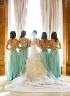 Mint bridesmaid dresses, a fluffy wedding dress, and a flowing veil: http://www.stylemepretty.com/2014/01/13/los-angeles-wedding-at-the-park-plaza/ | Photography: Esther Sun - http://www.esthersunphoto.com/