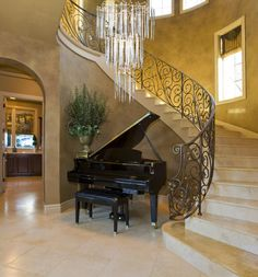 make it a less modern, and it would be perfect.  My check list for an entry way:  Grand piano  Chandelier  curved or spiral stair case