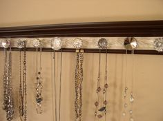 """Brown jewelry organizer. This wall necklace rack has 9 decorative knobs on a champagne embossed background 26"""" Closet organization storage by Gotahangup on Etsy https://www.etsy.com/listing/179093022/brown-jewelry-organizer-this-wall"""