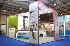 This stand design included curved buttresses as well as curved counters.  It achieved maximum impact by clever use of colour.  www.nimlok.co.uk