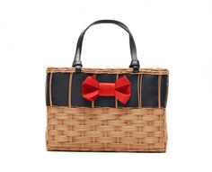 Our Edie basket, in wicker updated with a black grosgrain ribbon and red bow.