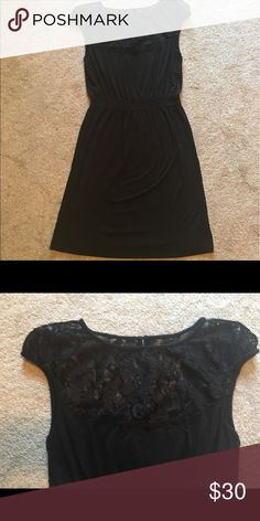 NWOT BLACK knit and lace dress Black knit dress with lace front and back yoke and cap sleeve. Banded waist and straight skirt. New and never worn Mark Dresses