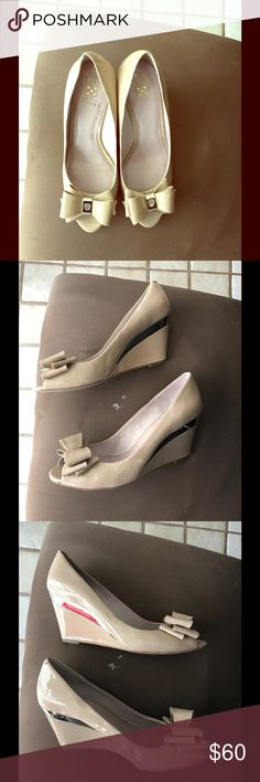 Vince Camuto bow peep toe wedges Nude patent leather bow peep toe wedges from Vince Caputo.  Perfect for Spring/Summer!  Only worn twice!  Great condition! Vince Camuto Shoes Wedges