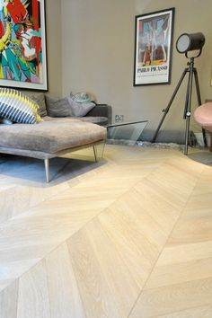 Contemporary oak chevron fitted in Baggot Street, Dublin. Boasting a beautiful, modern style created by the white oiled finish.