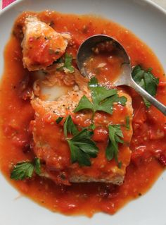 Fish fillets with vegetables and tomato sauce cooked in halogen (turbo) oven.