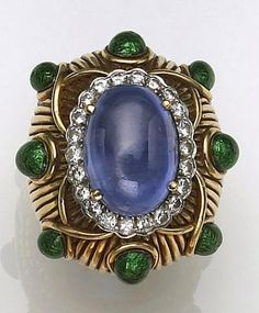 A sapphire, diamond, enamel, platinum and eighteen karat gold ring, David Webb the gold ring centering an oval-shaped sapphire cabochon, encircled by round brilliant-cut diamonds set in platinum, further accented by pear-shaped green enamel drops, set on ribbed scale motif; estimated total diamond weight: 1.20 carats