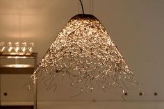"""From Vienna Design Week """"The Flying Jelly Fish"""" by Fanni Aliz Florian. Aluminium threated lampshade for an LED light. Photo by Brit Leissler for Jelly Fish, Vienna, Lighting Design, Darkness, My Design, Chandelier, Ceiling Lights, Led, Creative"""