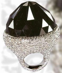 The worlds largest cut black diamond set into a white gold setting encrusted with 702 white diamonds.