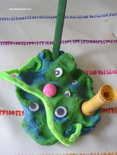 World Space Week Activities for toddlers and preschoolers making aliens out of playdough and bits and bobs. Using imaginative language to describe the aliens.