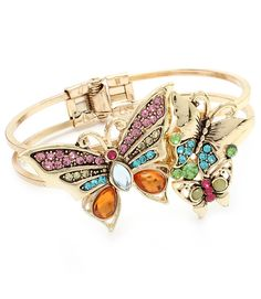 "This beautiful, multi-colored bracelet has a hinge-style closure and is adorned with crystal studs. Three butterflies of differing sizes decorate the top of the bracelet. Constructed with a metal. The bracelet has a 1 1/2"" width. Color: Multi-Colored - $59.99"