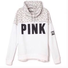 VS PINK Snow Leopard Cowl Neck Pullover NWT White and grey leopard print cowl neck hoodie.. Kangaroo pocket.  Oversized.  Black graphic on chest and sleeve.  New with tags.  Sold out. Very rare!  It's just a bit shorter on me than I would like. PINK Victoria's Secret Tops Sweatshirts & Hoodies