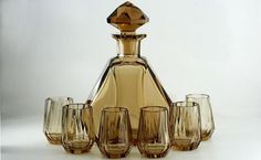 A stylish Deco topaz crystal decanter and six glasses set, the heavy decanter with an eight point facet stopper, facet...