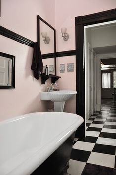 This is the general idea for the guest bathroom... Light pink walls, black trim & checkered floors