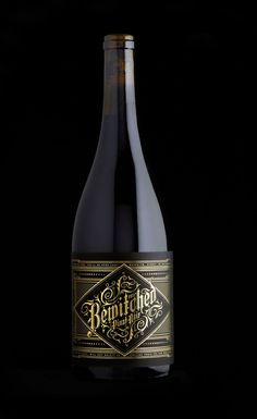 """Bewitched is a dark rich Californian red wine. The name is so good that you don't need to do too much apart from making it dark and sexy. The reserve level is screened matt back onto the bottle."""