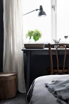 Masculine and simple desk space in window.