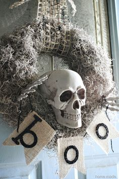 Spooky Skeleton Wreath.  DIY crafts & holiday decorating ideas. Creative front door & porch Halloween decor.