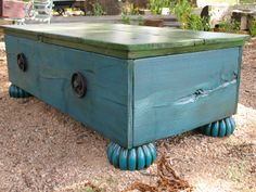 Pavo Real Furniture trunk with reeded feet and metal accents.