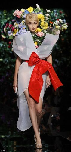 Flower power:Gigi Hadid, 22, and her sister Bella, 20, unveiled their biggest sartorial metamorphoses to date as they walked for Moschino's off-the-wall Spring/Summer '18 show during Milan Fashion Week