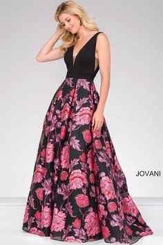 Floor length black and multi ballgown features a sleeveless bodice with a sheer plunging neckline and sheer sides and a hidden zipper in the back.
