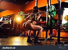 https://image.shutterstock.com/z/stock-photo-young-sports-sexy-brunette-woman-in-dark-red-gym-interior-do-squatting-with-barbell-exercises-671515585.jpg