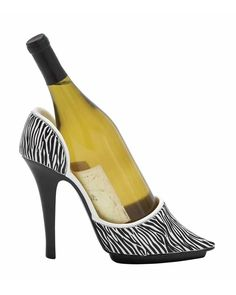 Zebra Striped Shoe Wine Holder - is carefully designed and is sure to garner attention. Crafted from premium-quality polystone material, this wine holder is resistant to easy wear or damage. The captivating design of this wine holder flaunts an attractive stiletto design with slender, pencil heels and a contoured body. With its attractive color combination and zebra strip print, this shoe-style wine holder will make a trendy addition to any casual dinner settings.