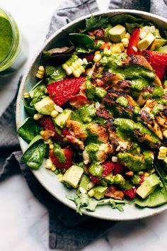 This juicy salad tastes like summer! With chipotle chicken, sweet corn, avocado, cilantro vinaigrette, bacon crumbles, and fresh strawberries for a pop of sweetness. #salad #summer #cobbsalad #chipotlechicken #cleaneating | pinchofyum.com