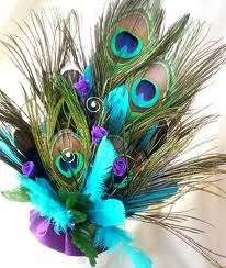 turquoise , and purple arrangement with a touch of peacock feathers!