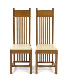 Pair of Oak Side Chairs, (American 1867-1959), circa 1908 - Raymond W. Evans House, / 9914 South Longwood Drive, Chicago IL / 1908 / Prairie / Frank Lloyd Wright -- Each having a horizontal crest rail over a spindle back, above the upholstered seat, raised on square legs joined by stretchers. Height 44 5/8 inches.
