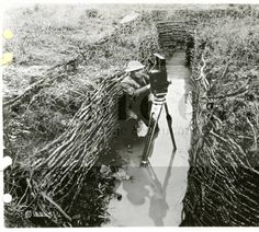 Signal Corps photographer attached to 26th Division takes photos in front line trenches :: WWI US Army Signal Corps Photographs Collection - USAHEC