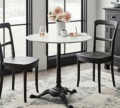 Inspired by those found in Parisian cafés, our Rae Round Marble Pedestal Dining Table features a decorative metal base and polished marble top. It's ideal for a cozy meal in a breakfast nook or for creating a stylish dining spot in a smaller space. Marble Bistro Table, Round Pedestal Dining Table, Square Dining Tables, Extendable Dining Table, Dining Sets, Bistro Table Set, Wood Pedestal, Plywood Furniture, House Furniture