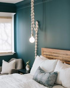 Bedroom goals at their finest. Inchyra Blue creates an intimate, cosy space in and we couldn't love it more! Blue Bedroom Decor, Cozy Bedroom, Bedroom Wall, Farrow And Ball Inchyra Blue, Cosy Room, Minimalist Room, Teal Walls, Farrow Ball, Decoration