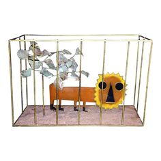 Adorable pop orange resin lion in brass cage with brutalist form patinated tree on sandstone decorated base. The lion is framed in brass with black. Mid Century Modern Art, Modern Artists, Brutalist, Sculpture Art, Cage, Vintage Antiques, Lion, Resin, It Cast