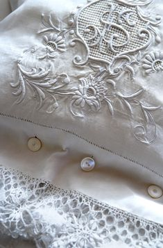 Beautiful pillowcase from hemstitched and monogrammed napkin. Crochet lace edging and vintage mother-of-pearl buttons (well at least 2 of them seem to be; the middle one is not, definitely!)