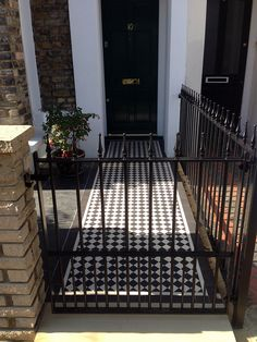 London Front Garden victorian mosaic tile path metal gate and rail