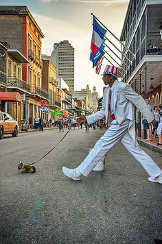 walking the dog - An image from New Orlean's Bourbon Street in the French Quarter.  Uncle Sam is famous for striking this pose. I have seen him posing in the French Quarter for 10 years www.johnjmillerphotography.zenfolio.com