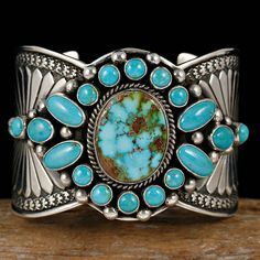 Southwestern western featuring a center turquoise with beautiful matrix and circled with  blue turquoise with minimal matrix.