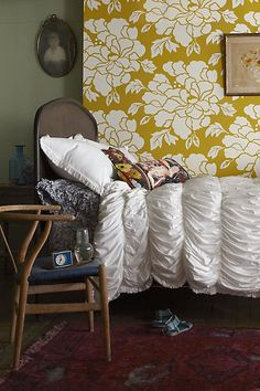 love everything about this: the wallpaper, the bedding, the chair-nightstand