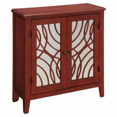 """Wood accent cabinet with 2 shelves behind mirrored doors with an overlapping circle motif.    Product: Accent cabinet. Construction Material: Wood and mirrored glass. Color: Red. Features:  Two doors, Two interior shelves.  Dimensions: 32"""" H x 32"""" W x 12"""" D. Joss and Main"""