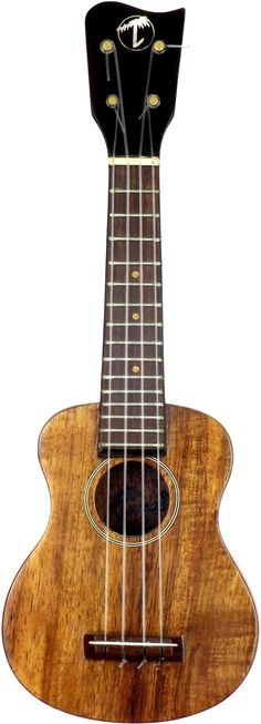 lardyfatboy: New pics of my Tiny Tangi koa Mini scale Ukulele The actual scale length is 168mm (65/8in) and its suppose to be the smallest playable Ukulele in the World - there are videos of one actually being played on YOUTube (not this one Tangi made a few of them but the y are all the same size) The pic of it next to the dollar bill is to give a sense of scale (that even Americans will understand - if I had used a different currency they would not for the most part know how big the note…