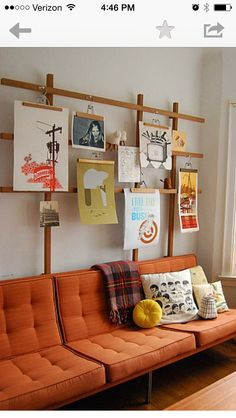 """Poster wall On The Grid: Sadly, this Etsy seller is no longer making this awesome wooden """"frame"""" but we're confident you could DIY your own version with just a few pieces of thin board. (via Apartment Therapy) http://www.apartmenttherapy.com/how-to-hang-pictures-without-leaving-holes-in-the-wall-205607"""