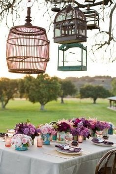 not a fan of the hanging bird cages, but look at those flowers!