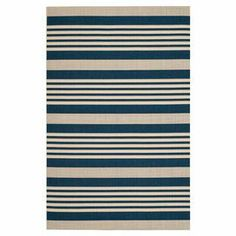 Loomed indoor/outdoor rug with navy and beige striping.  Product: RugConstruction Material: PolypropyleneColor: Navy and beigeFeatures:  Made in TurkeyPower-loomed Note: Please be aware that actual colors may vary from those shown on your screen. Accent rugs may also not show the entire pattern that the corresponding area rugs have.Cleaning and Care: Professional cleaning recommended
