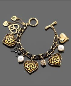 Betsey Johnson Leopard Heart bracelet - I made a knock off of this a few years ago from materials I already had (vintage jewelry, etc) and a few things I got at the craft store. It has been a huge hit every time I've wore it :)