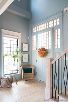 Fresh Ideas for Fall Home Tour! - Addison's Wonderland Inside our 1905 historic home featuring powder blue gray walls, black window sashes, craftsman style blue front door and beautiful black iron railing. Fall decor from HomeGoods! Sponsored by HomeGoods. #sponsored