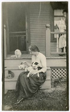 woman with kittens and an adorable goofy terrier, maybe Jack Russell.